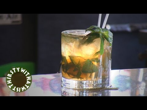 (HD) How to make a mint julep cocktail with kentucky derby horses casually mixed in!